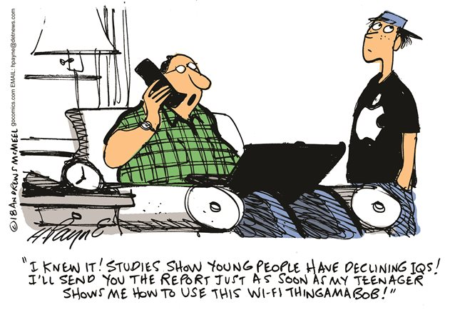 A cartoon showing a tech-challenged father speaking on the phone about a study showing declining IQs in youth yet reliant on his teenage son to work his laptop computer
